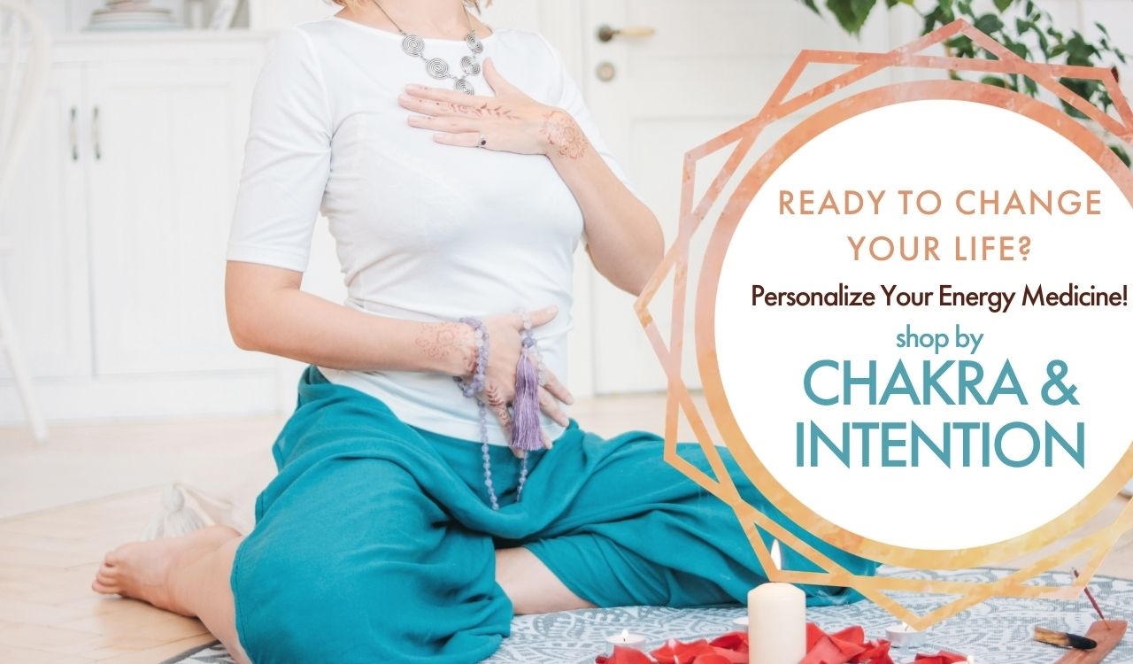 Cross Legged playing crystal singing bowls on floor:: Reads to change your life? Personalize your energy medicine! Shop by Chakra & Intention