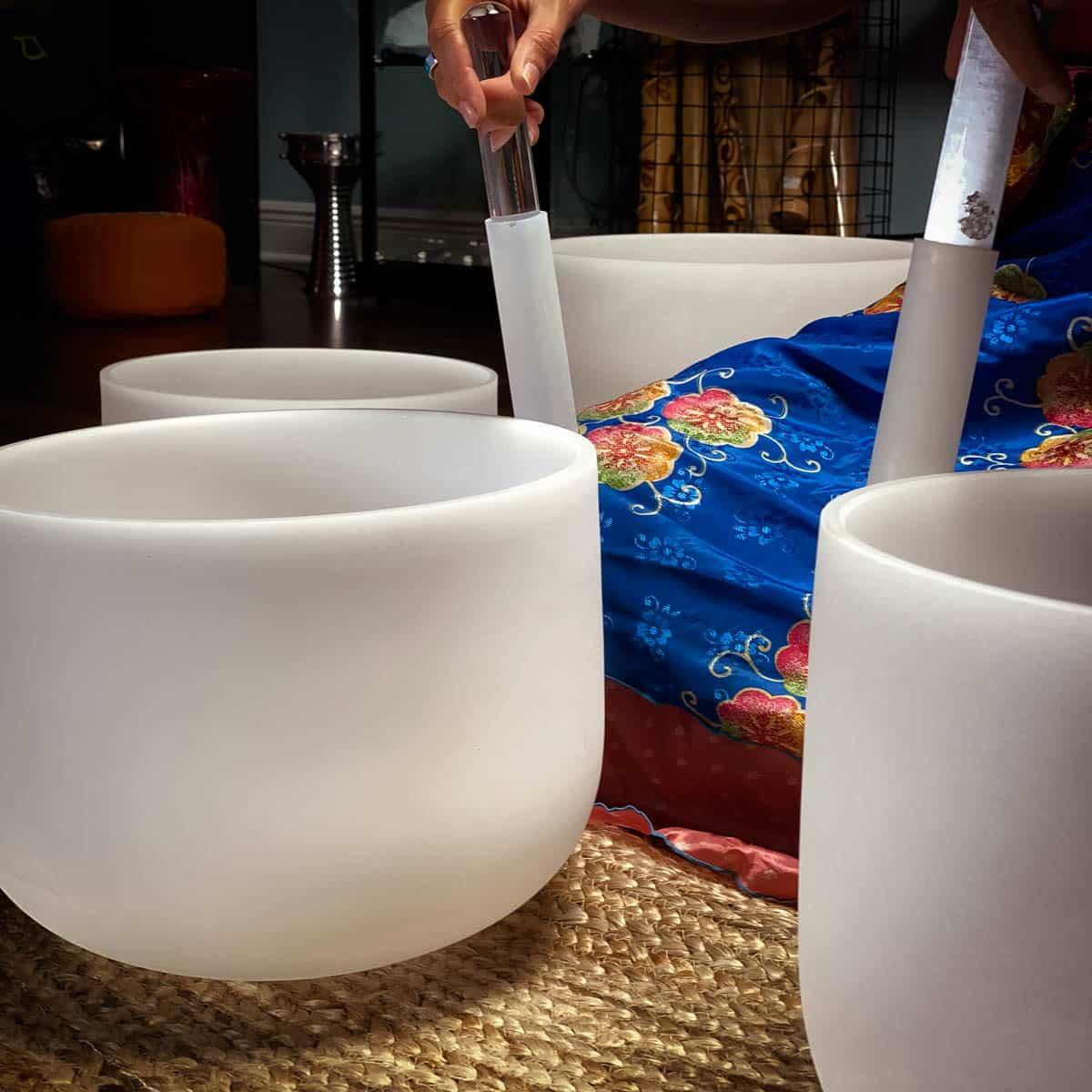 Close Up Playing Crystal SInging Bowls The OM Shoppe Chakra Set