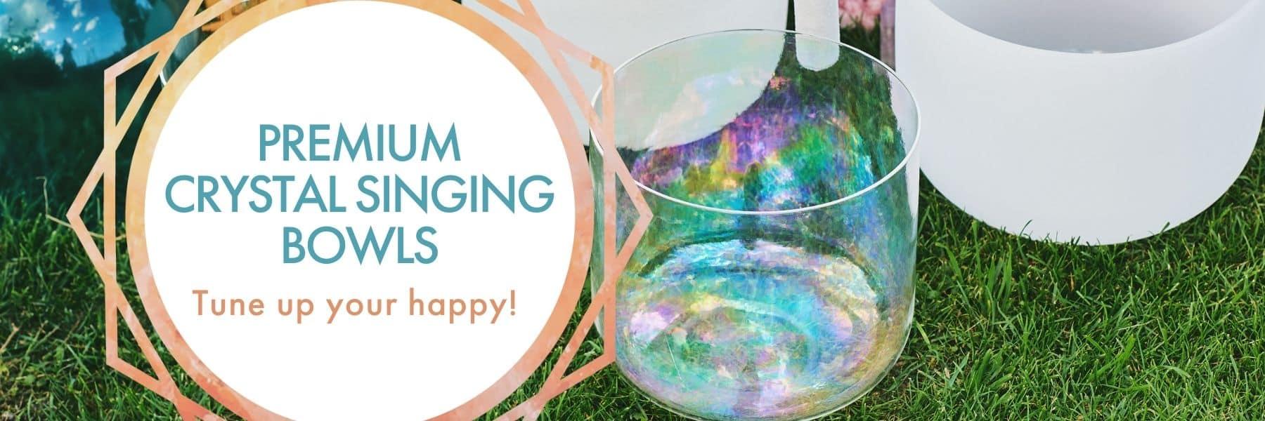 Banner: Premium Crystal Singing Bowls; beautiful crystal singing bowls being played in the grass