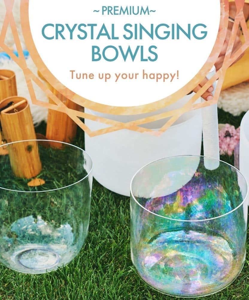 Mobile Banner: Premium Crystal Singing Bowls; beautiful crystal singing bowls being played in the grass