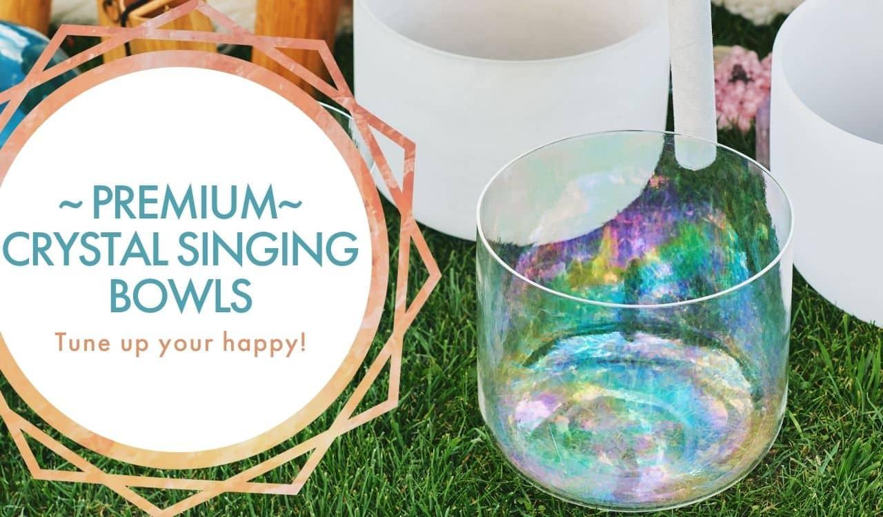 Tablet Banner: Premium Crystal Singing Bowls; beautiful crystal singing bowls being played in the grass