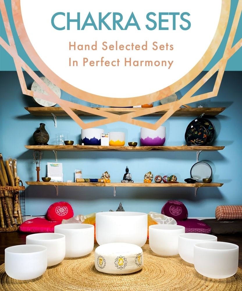Chakra Sets: Hand Selected in Perfect Harmony; frosted crystal singing bowls chakra set with display of sound healing instruments