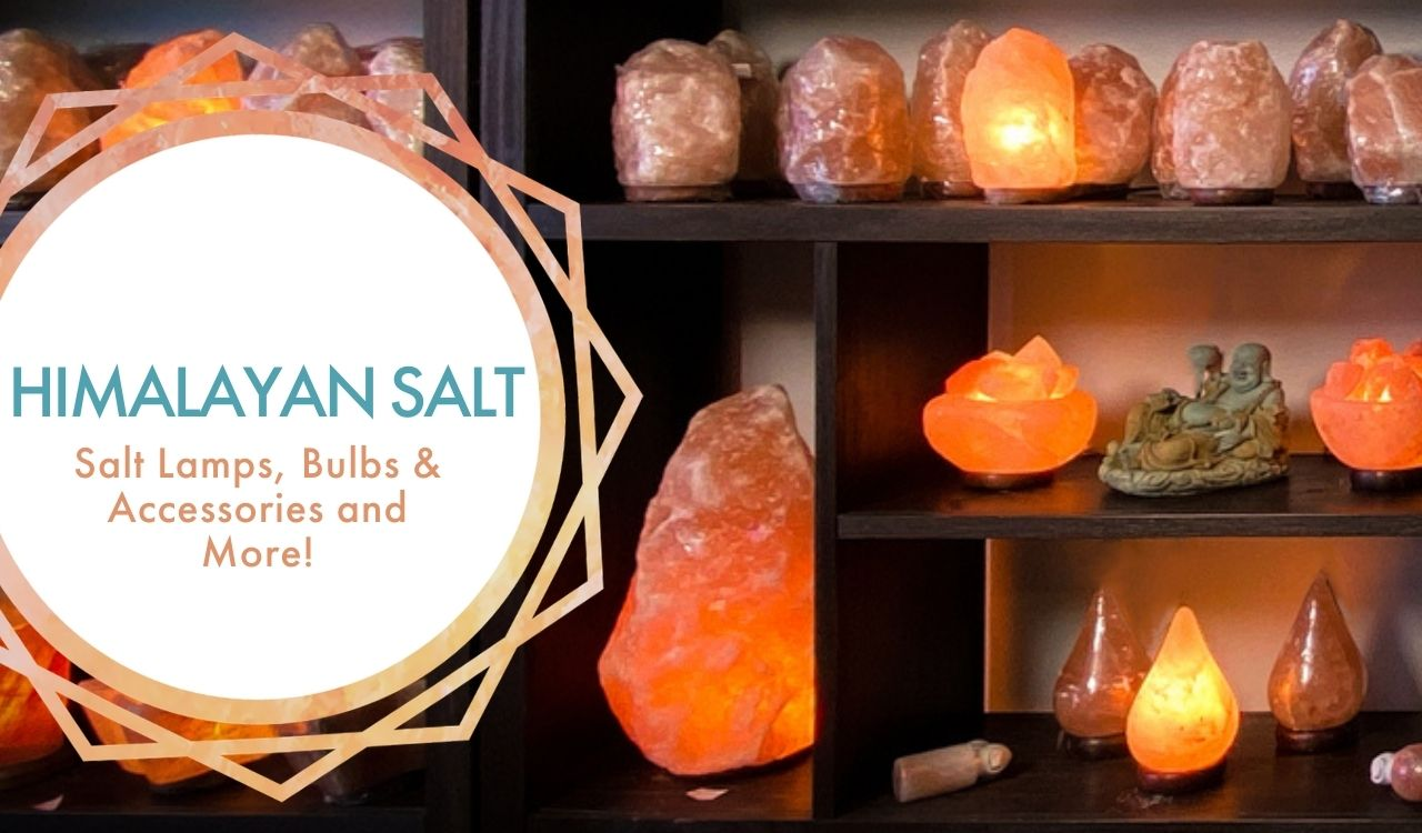 Himalayan Salt: Salt lamps bulbs, accessories and more!; against backdrop of wall unit shelf with assorted salt lamps displayed