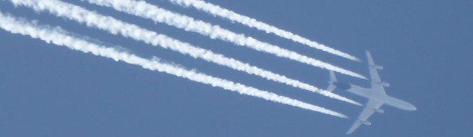 Passenger plane with contrails