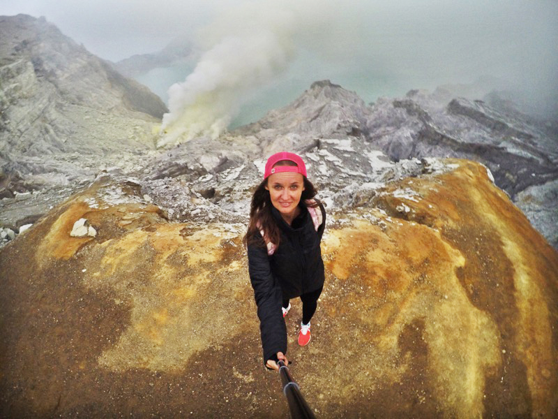 Kawah Ijen volcano, The One Who Wanders overlooking the lake which is one of the most acidic lakes in the world