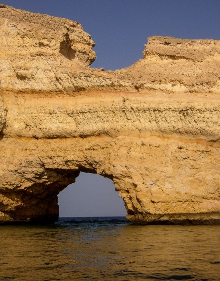 Here, the rock formation is clearly the subject, but has to be seen to be in the sea, so 2/3rds is the logical choice. Taken on a boat trip off Muscat, in Oman.