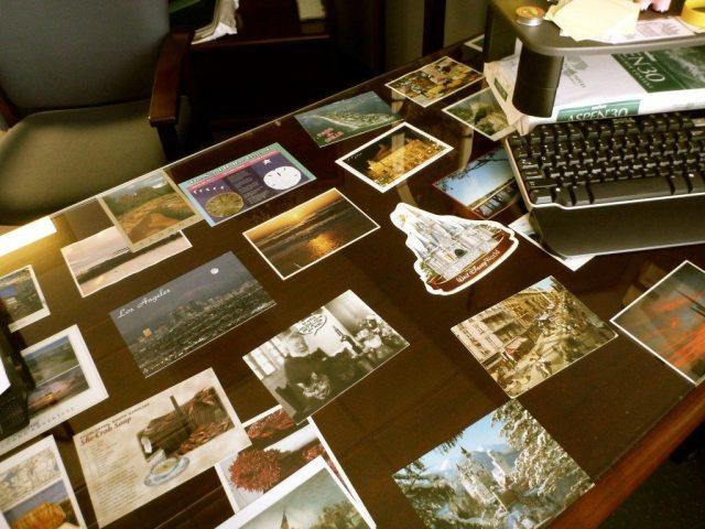 postcards-under-desk-decorating-office