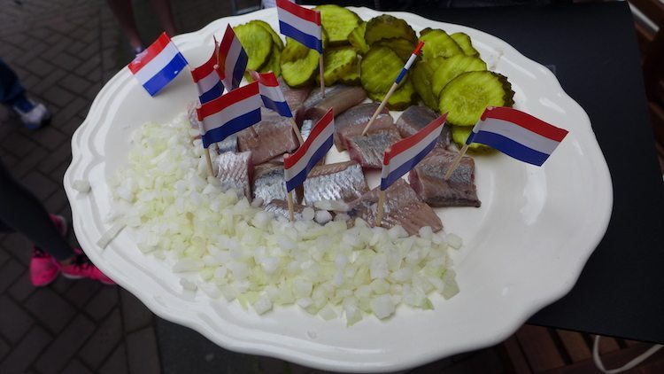Herring, pickles and onions served during an Eating Amsterdam Dutch food tour