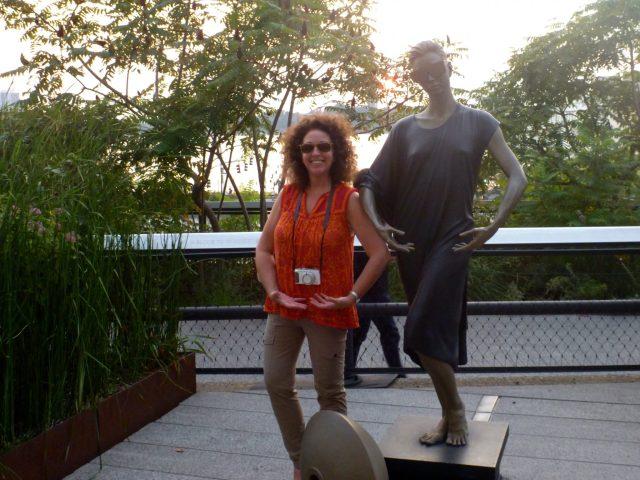 Tourist and statue