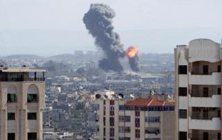 An explosion is seen during Israeli air strikes in Gaza