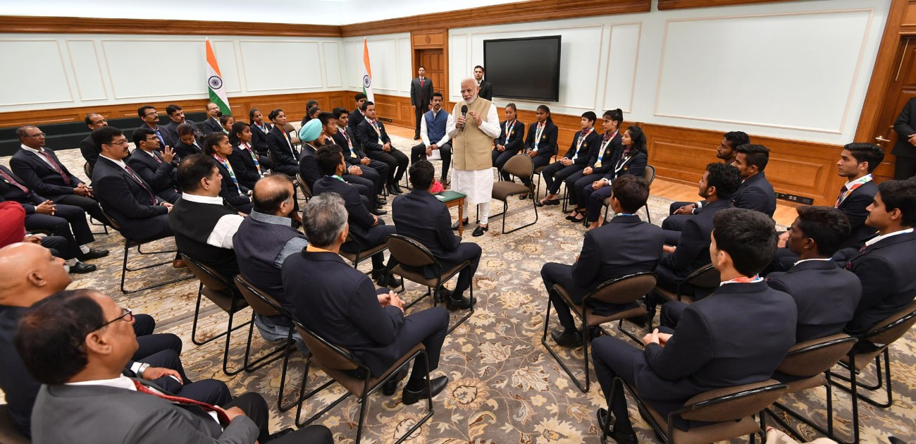 The Prime Minister, Shri Narendra Modi interacting with the medal winners of the 2018 Summer Youth Olympics, held in Argentina, in Delhi on October 21, 2018-2-pib