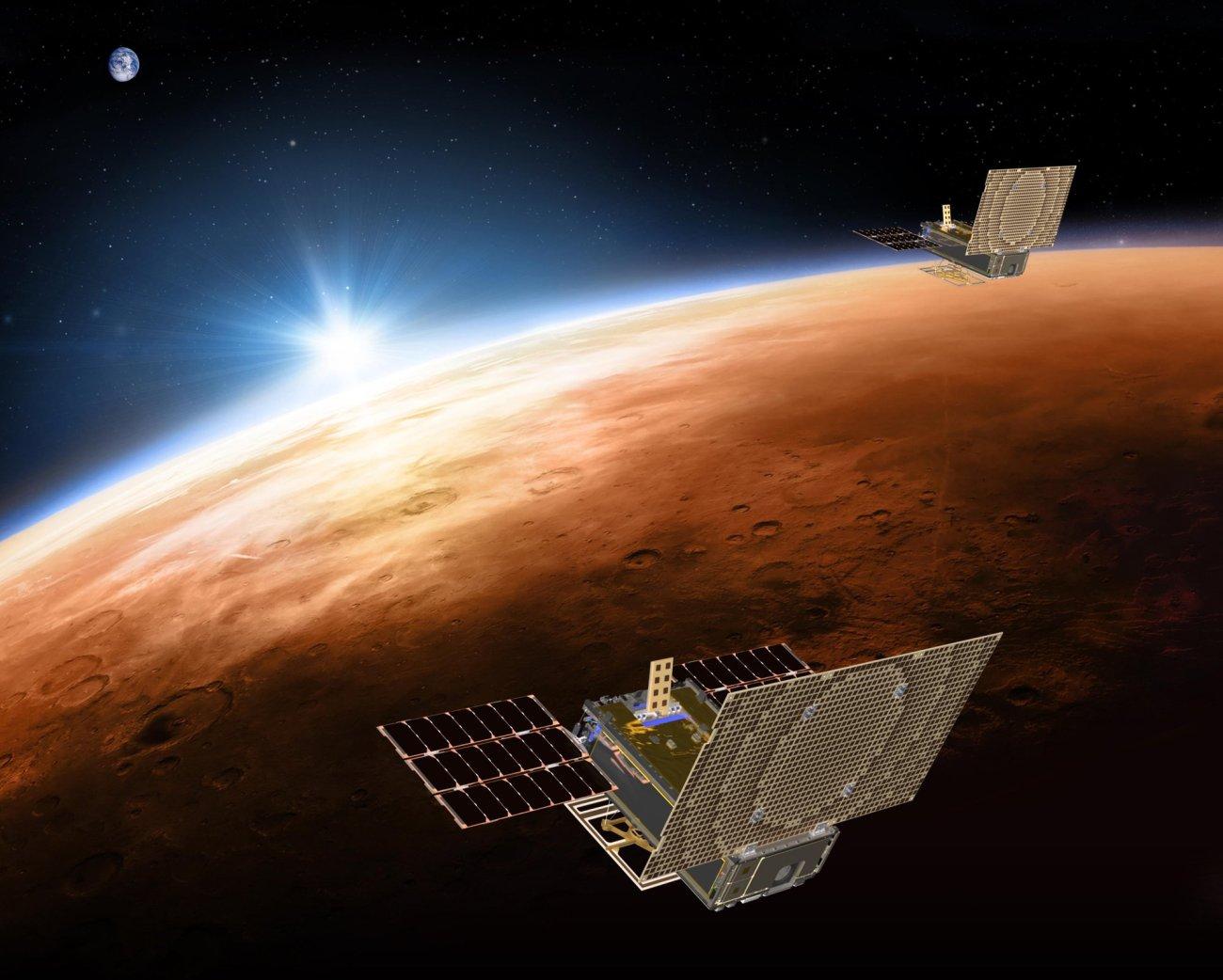 tiny satellites trailing Mars lander- AP