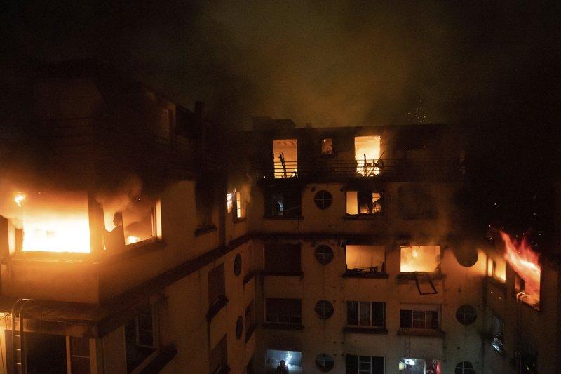 Paris apartment fire kills 8; police suspect arson