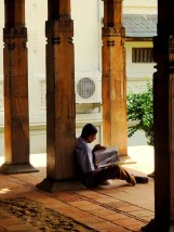 Reading in the ground of the Temple of the Sacred Tooth, Kandy