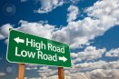 cutcaster-photo-100716106-High-Road-Low-Road-Green-Road-Sign