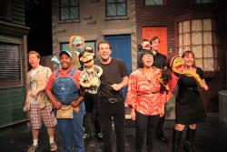 "AUSTIN BAUMAN In its staging of the satirical 2003 musical ""Avenue Q,"" Maverick Theater features, from left, Curtis Andersen as Brian, Adair Gilliam as Gary Coleman, Tyler McGraw as Princeton, Bachi Dillague as Christmas Eve, Rachel McLaughlan as Kate Monster and, behind them, Kevin Garcia as Nicky and Michael Rodriguez as Rod."