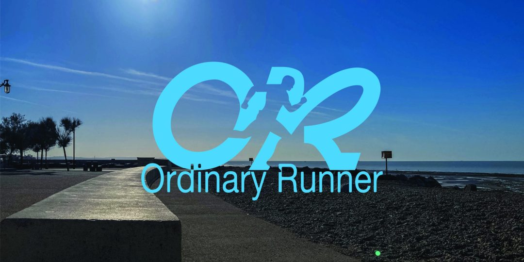 Seaside path and the sun sat high in a blue sky. Overlaid by the Ordinary Runner logo