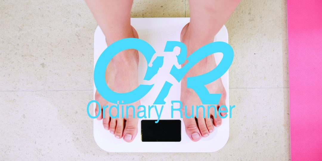 Someone standing on bathroom scales overlaid by the Ordinary Runner logo