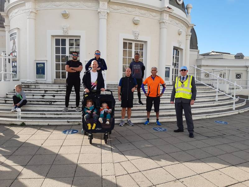 A group of dads outside Worthing pier ahead of the Dad La Soul 10k run for World Mental Health Day sponsored by The Ordinary Runner