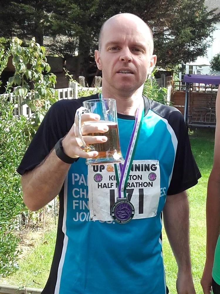Me, drinking a beer with my Kingston Half Marathon medal around my neck - running tracks