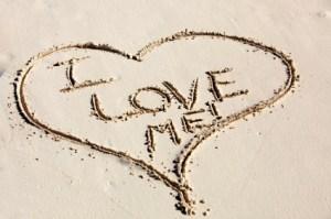 I Love Me Written inside a Heart Drawn in Sand