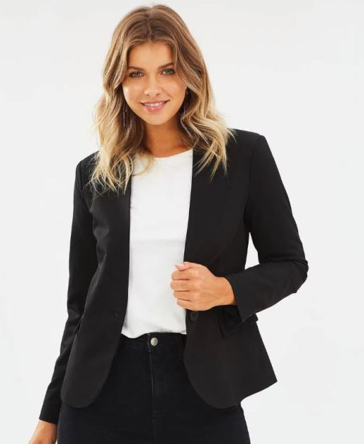 female dressed in black blazer and white top