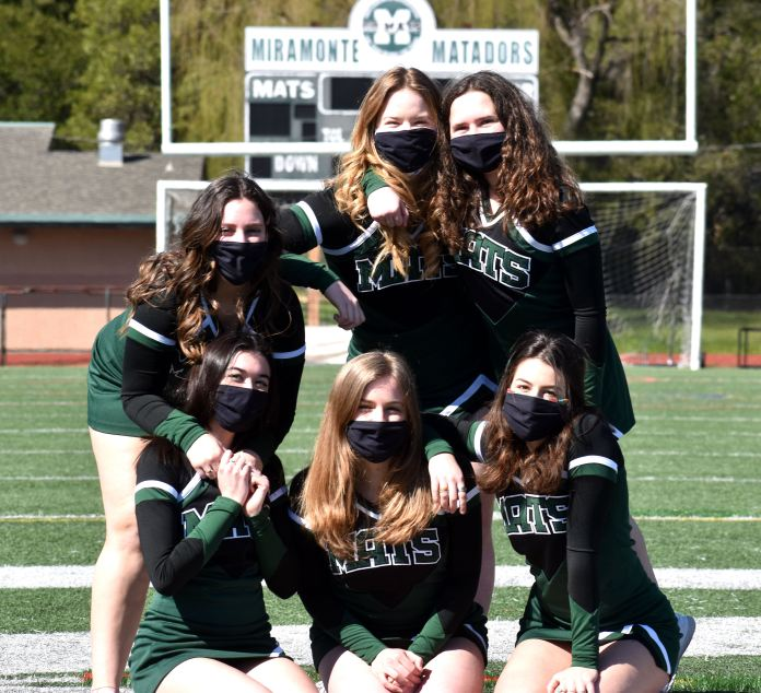 (Wendy Patrick, Photographer)Sideline Cheer Seniors (Back row: Sydney Swinton, Mia Trani; Middle: Julia Jungbluth; Front Row: Aine Flynn, Cara Holden and Zoe Jeffrey) gave an enthusiastic welcome to all the teams during a compressed season. See story Page 8.