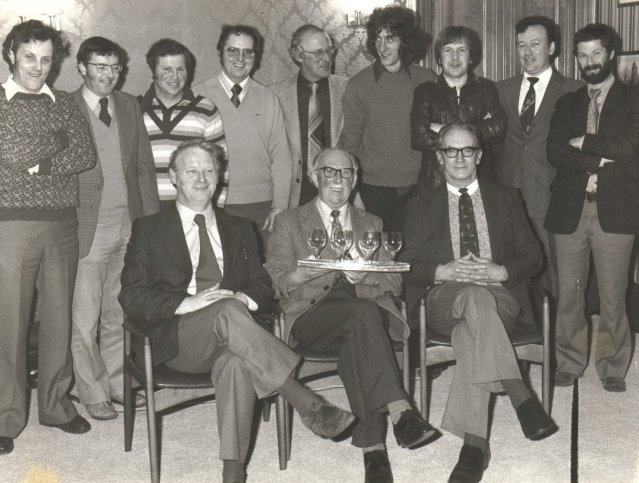 1970s - seated David Kemp, Murdo MacD & Jim Gibson. Behind - David Tinch, Magnus Ritch, R. Groundwater, Alan Lobbin, John Shearer, Jackie Shearer, Thorfinn Johnston, R. Robson and Donald