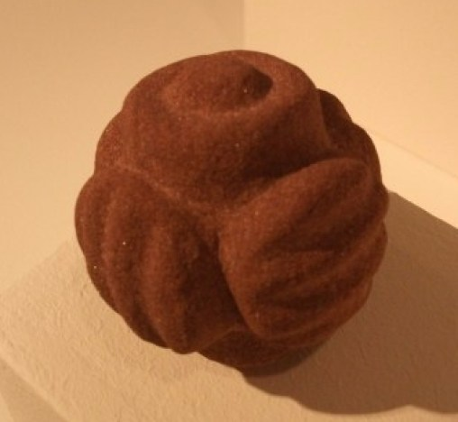 Carved stone ball by Chris Gee