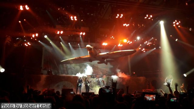 Iron Maiden playing Aces High, a Spitfire over the stage. Photo by Robert Leslie.