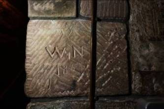 Stonecarved name and date over toolmarks. Credit: Dr Antonia Thomas.