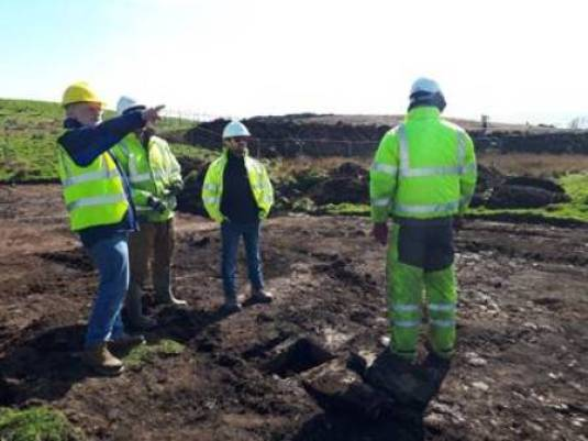 Pete Higgins, ORCA Archaeology Senior Project Manager, points out archaeological sites visible from the cist location