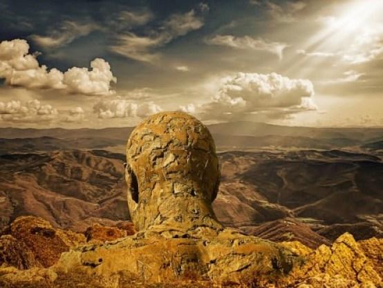 stone man in clouds
