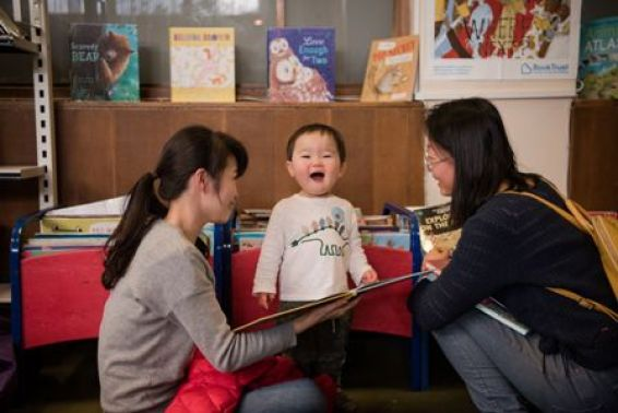 Family reading at Fountainbridge Library. Image by Rachel Hein