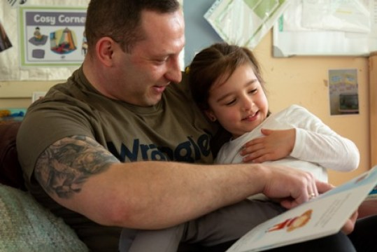 Father and daughter reading. Image by Jonathan Ley