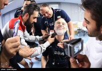 Iran team's manager, Mr. Khoshkhabar, in the changing room after the match against Poland: He promised the team that he would shave his beard off when Iran qualified for Olympics.