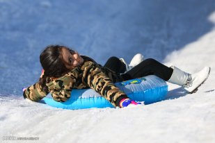Winter joys - Snow sliding at Shemshak in Tehran Province, Iran (Photo credit: MEHR News Agency)