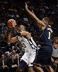 Penn State's Brandon Taylor looks for a shot past Michigan's Glenn Robinson III
