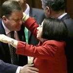 Connecticut lawmakers embrace after passing gun control law