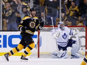 Bruins defenseman Chara reacts to a goal during Boston's third-period rally