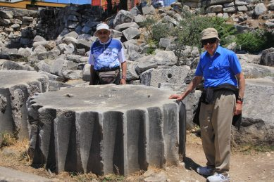 Seeing the column sections on the ground gives you an idea of their massive size. Dad & Dick giving some scale.