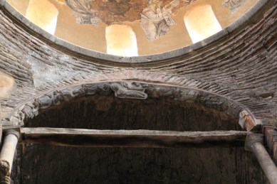 Where the reliefs are suspended under the dome.