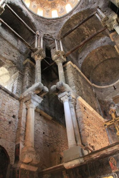 Columns are inserted through the walls to support the next level of columns above