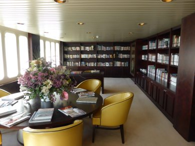 The library, stacked with books about the places we are visiting, as well as fiction, games and a daily newspaper.