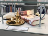 """There are little displays among the shelves """"illustrating"""" the books."""