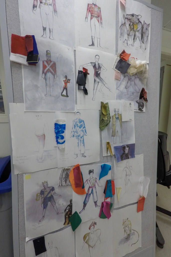 Sketches and fabric samples for costumes,