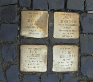 A group of plaques remembering people who lived here, who were killed in the Holocaust