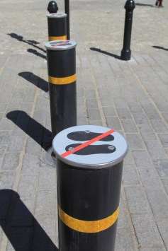 They need a warning to stop people standing on these bollards??!