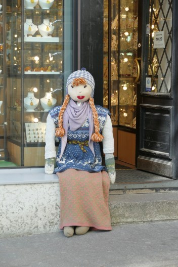We saw life-sized dolls like this advertising (I assume) the goods on the doorsteps of lots of shops