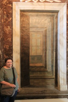 Interesting trompe l'oeil doorways. And me.